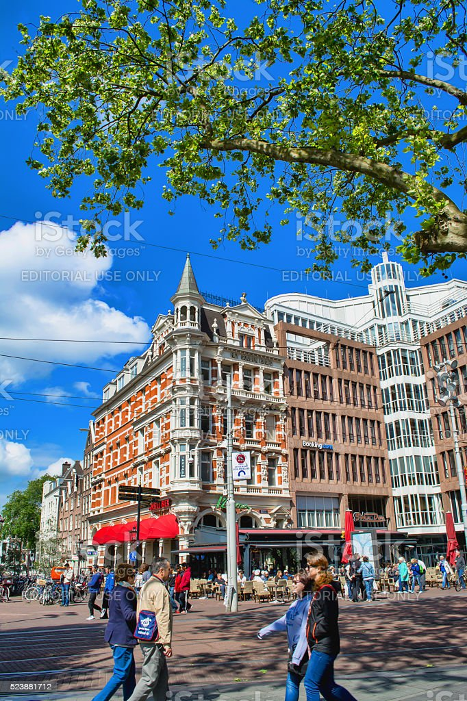 Street with the house in Amsterdam on a sunny day. stock photo