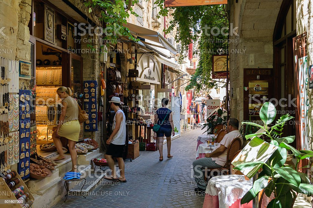 Street with tourists and souvenir shops in Chania stock photo