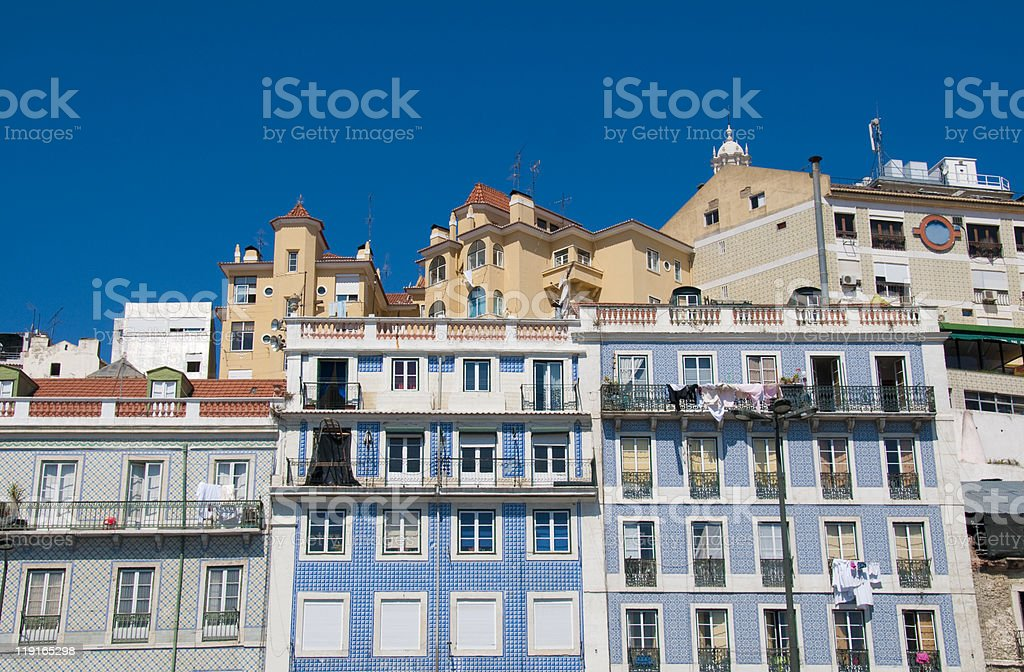 Street with traditional apartments at Lisbon Portugal royalty-free stock photo