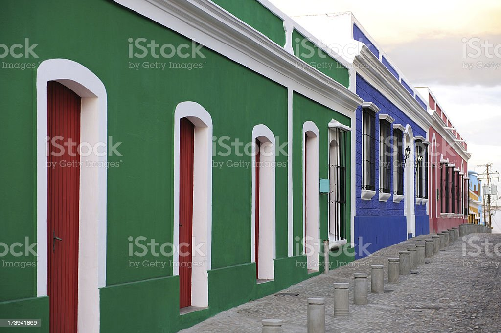 street with tropical colored houses stock photo