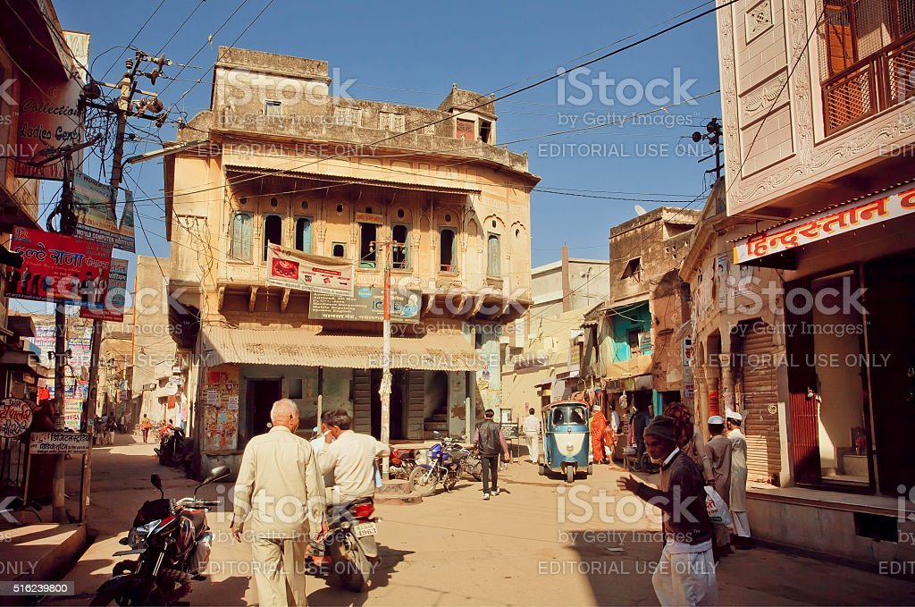 Street with walking people and historical houses stock photo