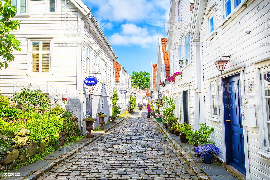 Street with white wooden houses in old centre of Stavanger. stock photo