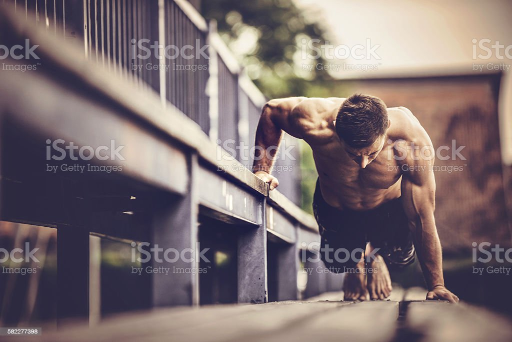 Young muscular man working out