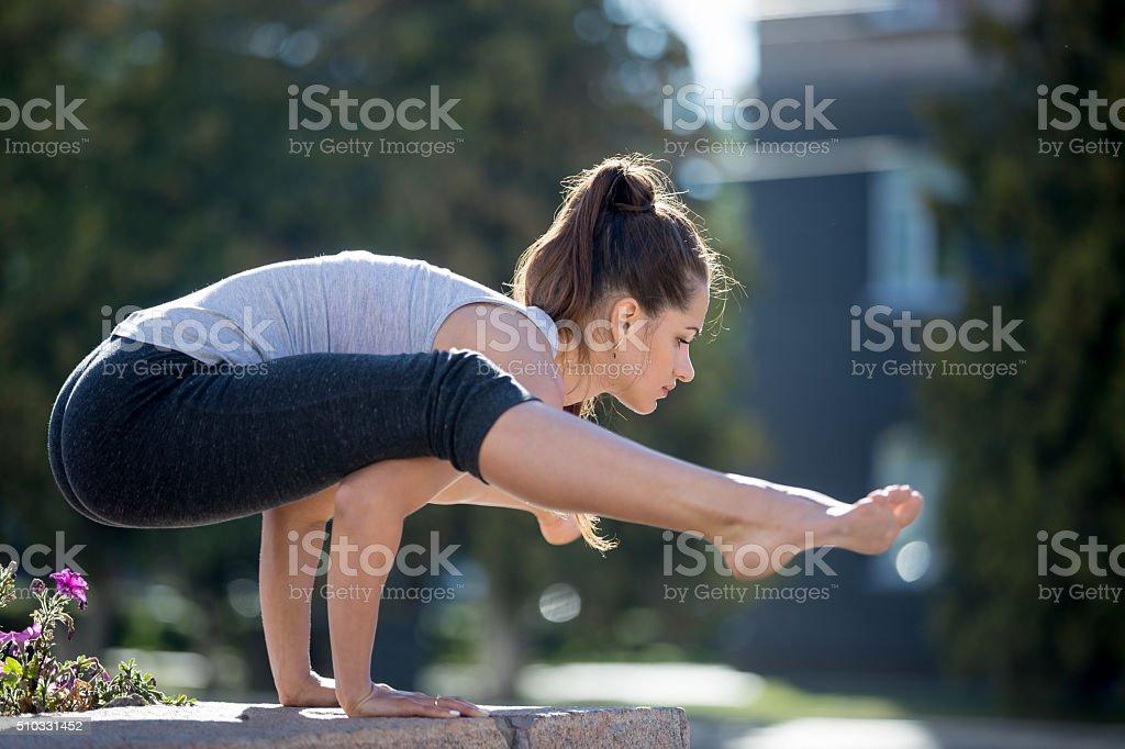 Street yoga: Firefly asana stock photo