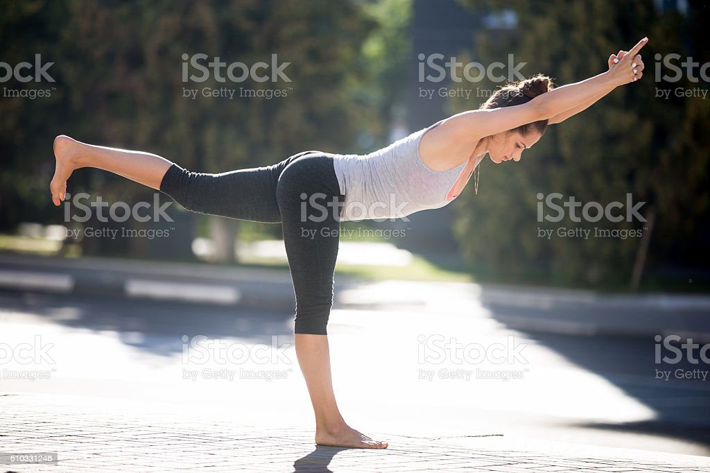 Street yoga: Warrior 3 Pose stock photo