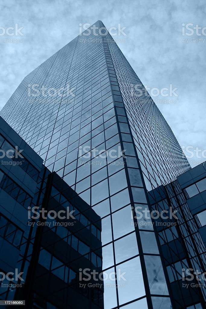 Street-level view of a skyscraper building of glass windows royalty-free stock photo