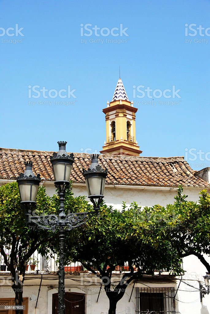 Streetlight and church in town square, Estepona. stock photo