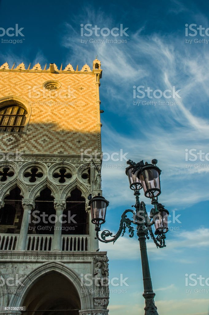 Streetlight in ther corner of Doge's palace stock photo