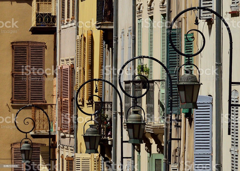 Streetlights and old windows in Antibes stock photo