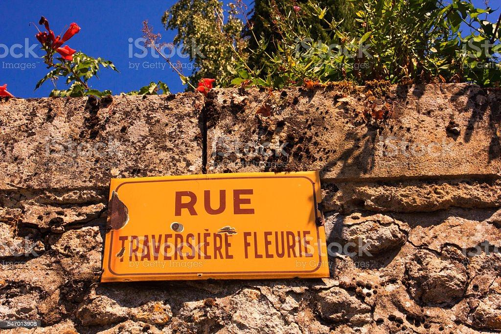 Streetname Rue Traversiere Fleurie stock photo