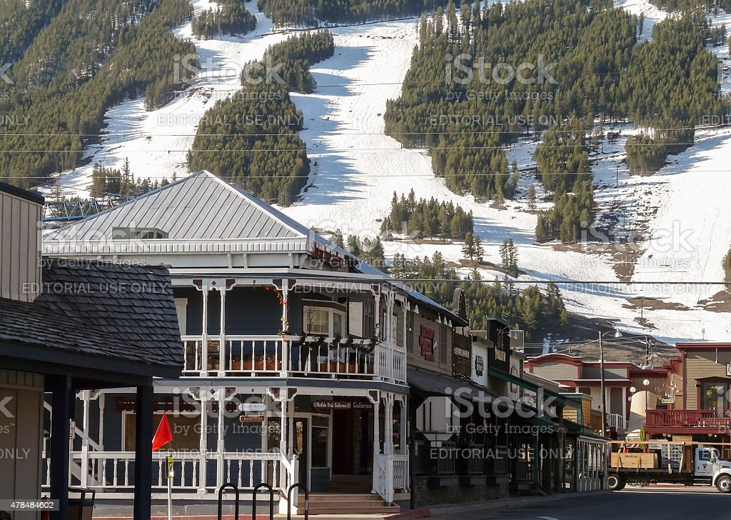 Streets of Jackson Hole with ski slopes at background stock photo