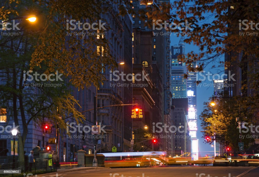 Streets of Midtown Manhattan by night stock photo
