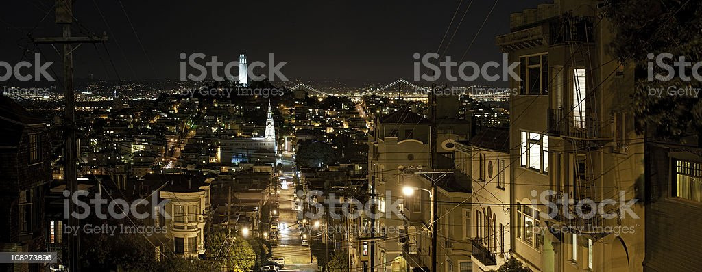 Streets of San Francisco night Coit Tower Bay Bridge panorama stock photo