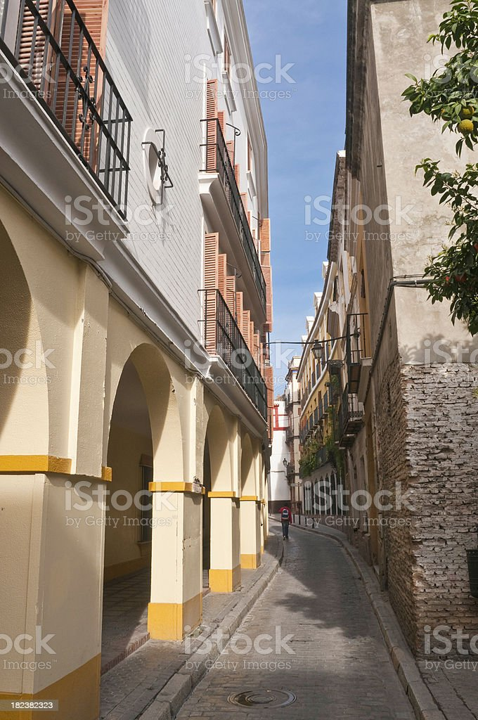 Streets of Seville quiet alleyways arches whitewashed villas Andalusia Spain royalty-free stock photo