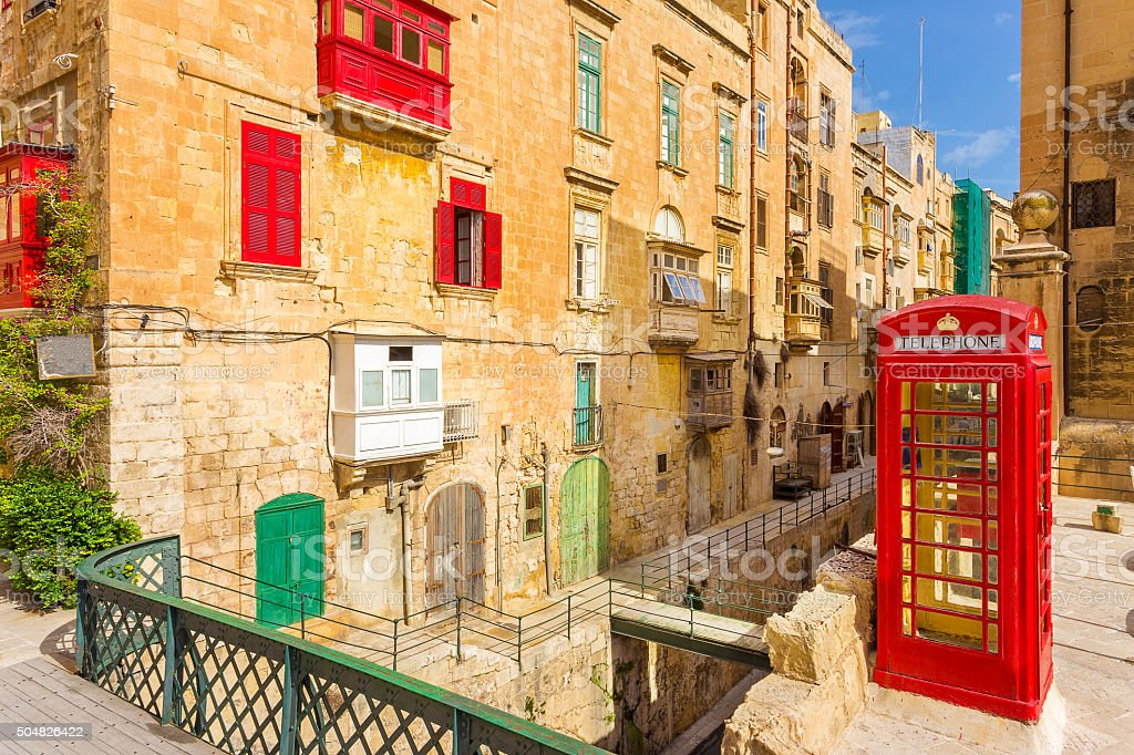 Streetview of Valletta with traditional red balconies - Malta stock photo