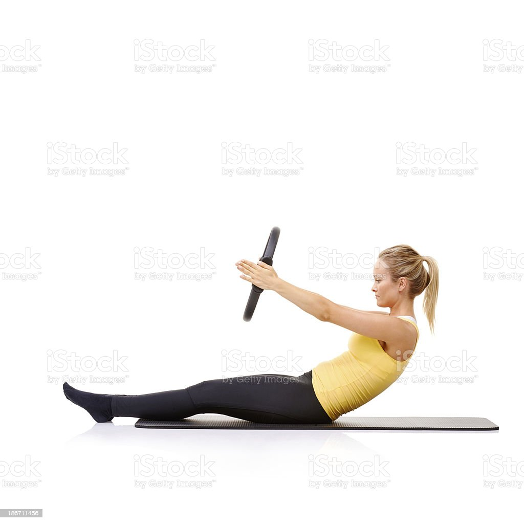Strengthening her core muscles royalty-free stock photo