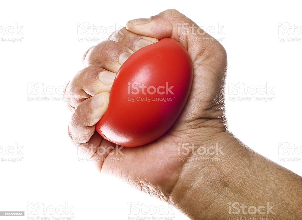 Stress ball in hand stock photo