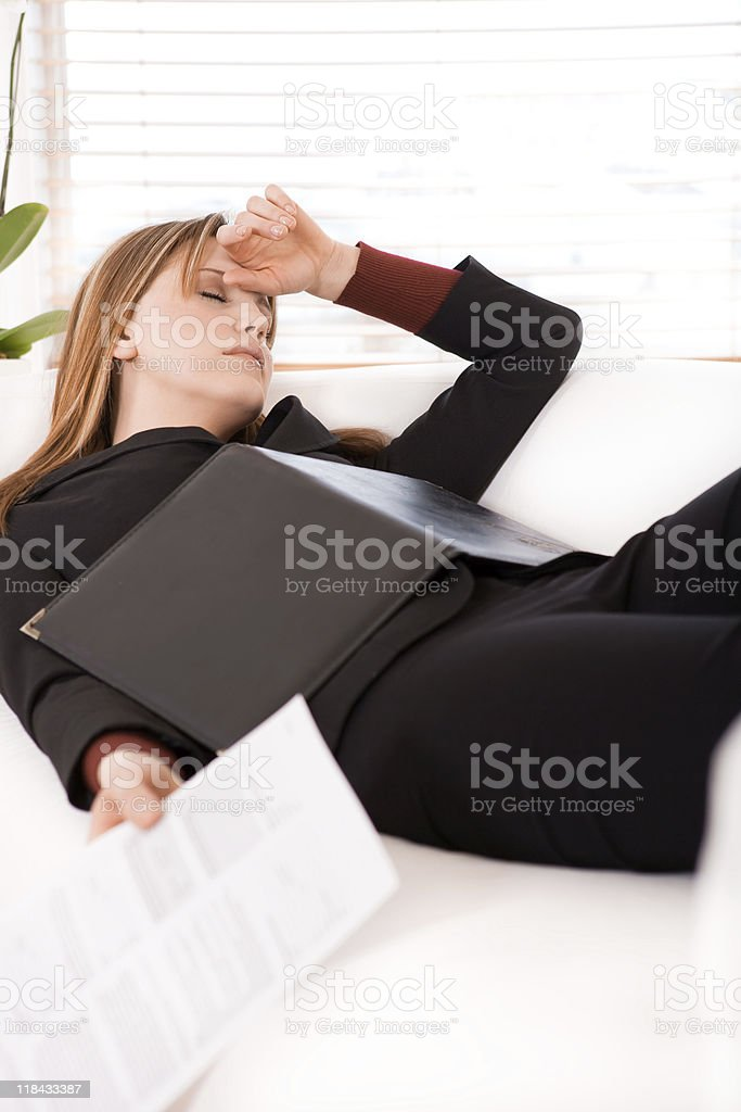 Stress Businesswoman laying on the sofa royalty-free stock photo