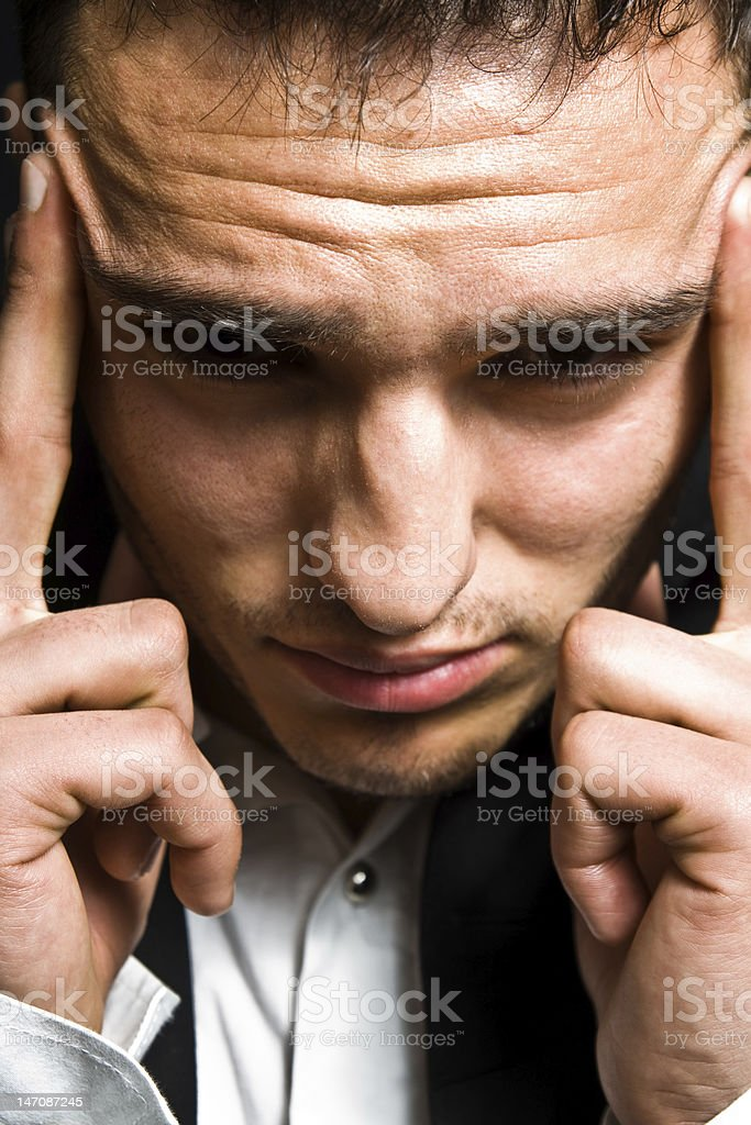 Stress concept - business man with headache stock photo