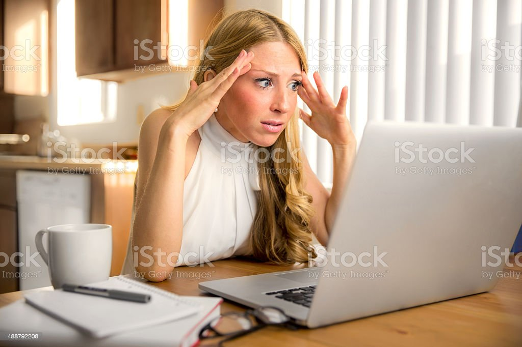 Stress frustrated panic news email reading laptop computer depressed stock photo