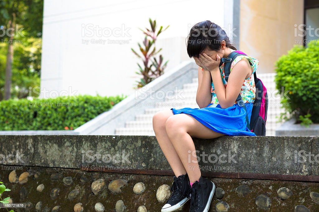 stress  girl sitting and  thinking in the school stock photo
