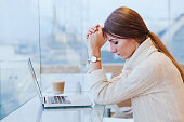 stress, sad tired woman near computer