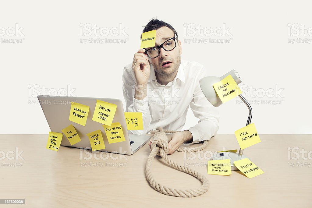 Stressed and depressed office worker with post-it notes royalty-free stock photo