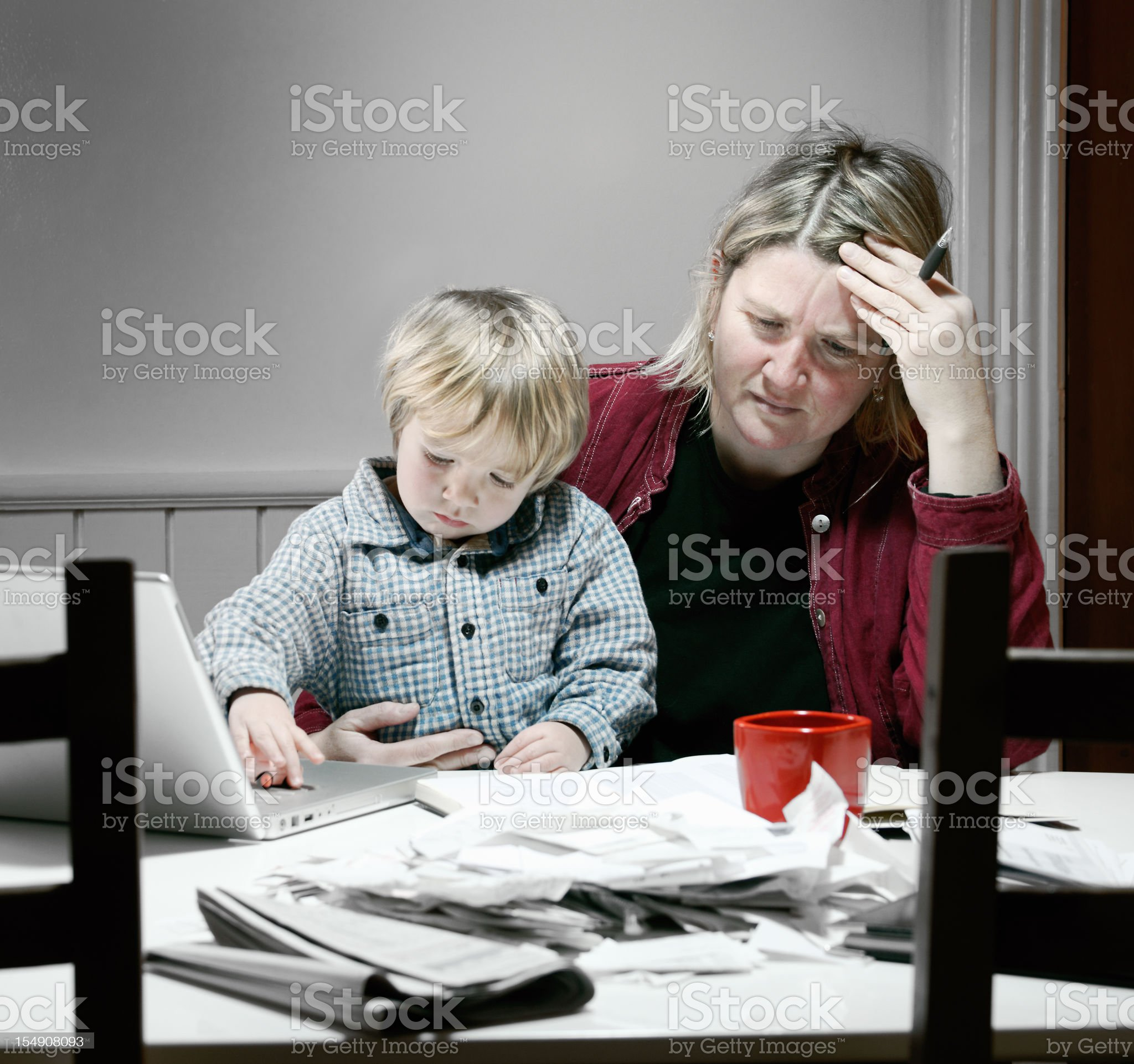 Stressed and tired mother working on financial issues royalty-free stock photo