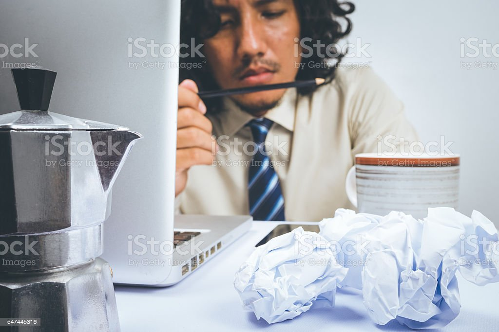 Stressed Asian business man stock photo