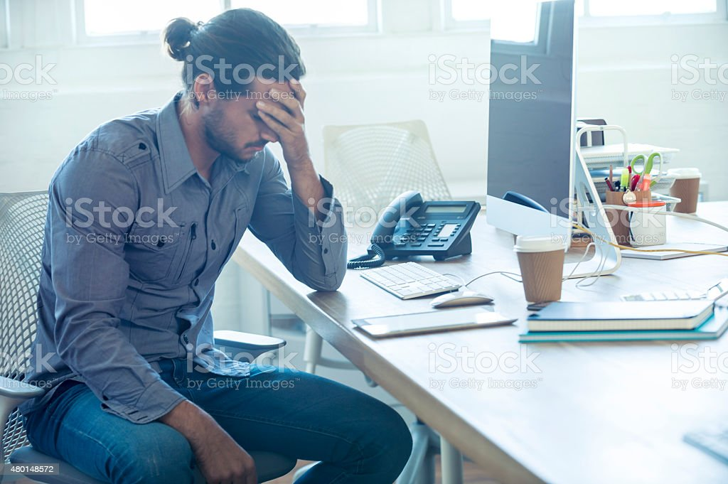 Stressed business man at the office. stock photo