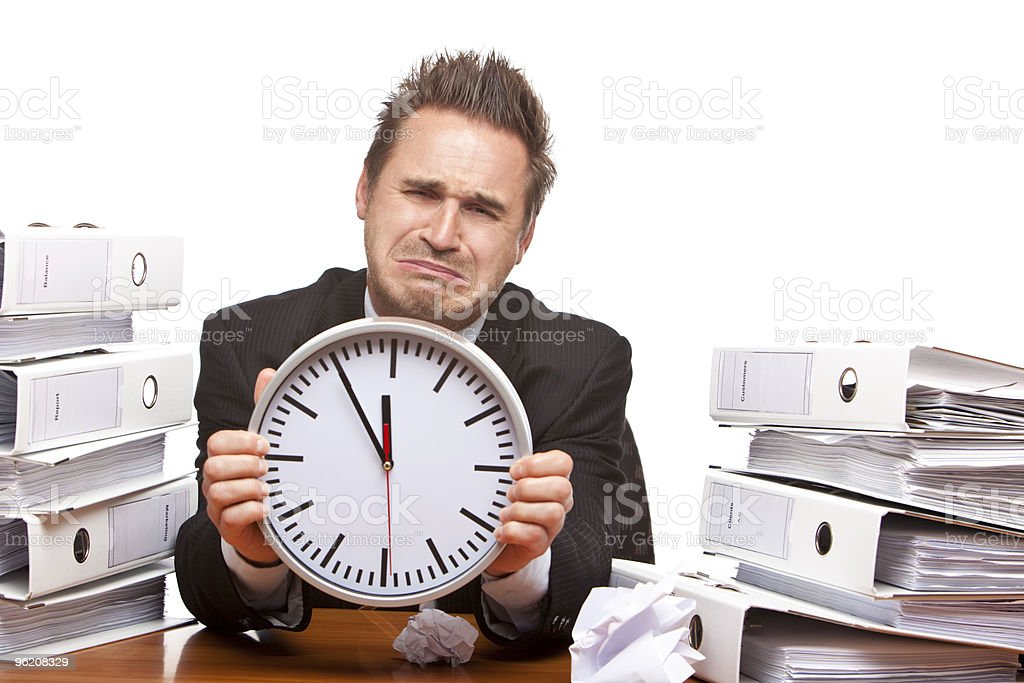 Stressed business man under time pressure cries in office royalty-free stock photo