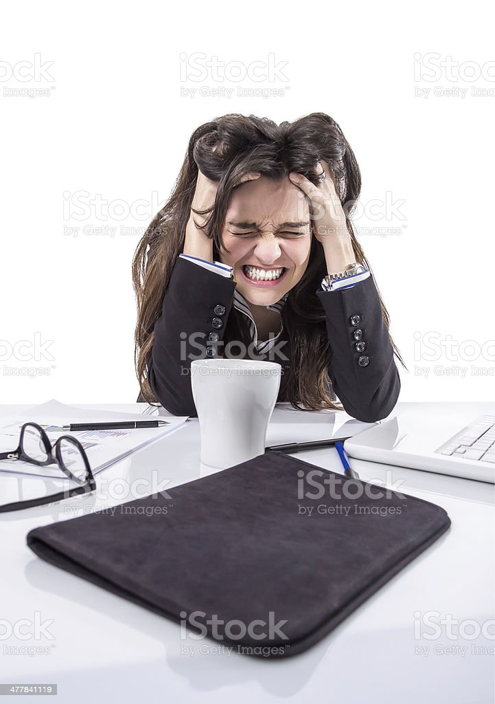 Stressed business woman pulling her hair stock photo