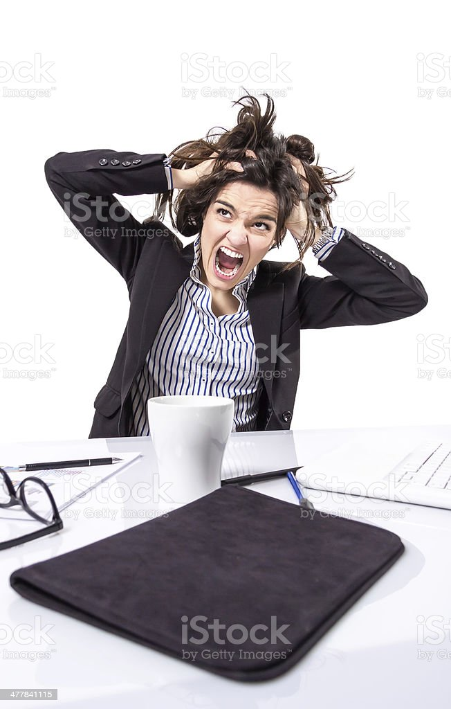 Stressed business woman screaming and pulling hair stock photo