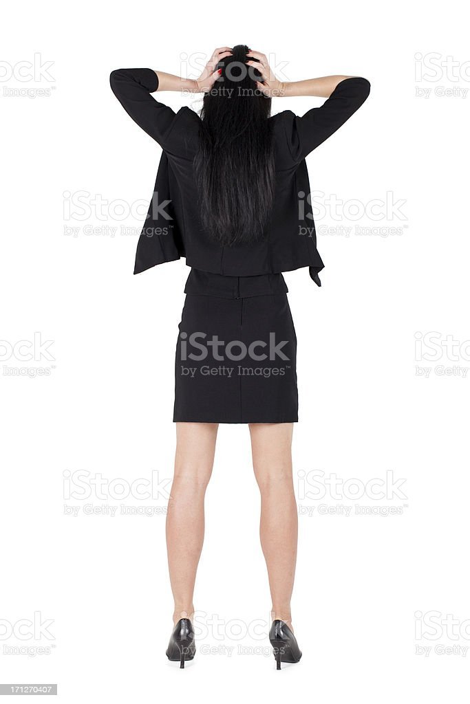 Stressed business woman standing backwards hands on hair royalty-free stock photo