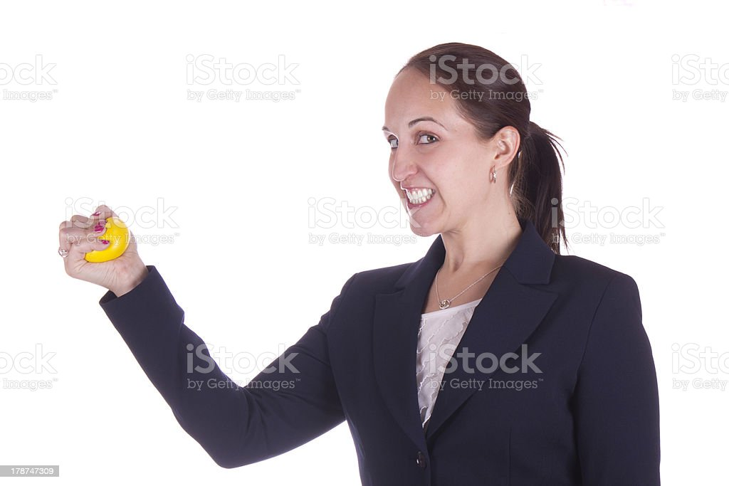 Stressed business woman with stress ball stock photo