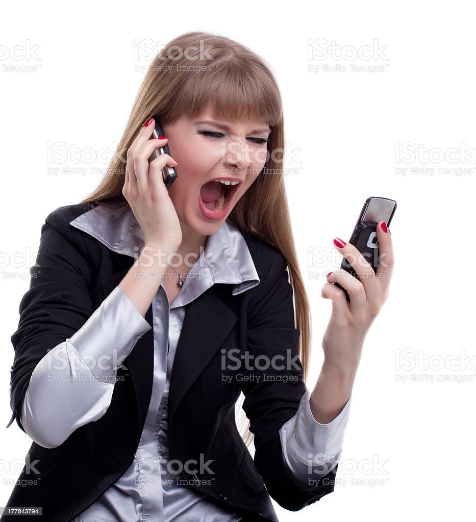 Stressed business woman with two cell phones royalty-free stock photo