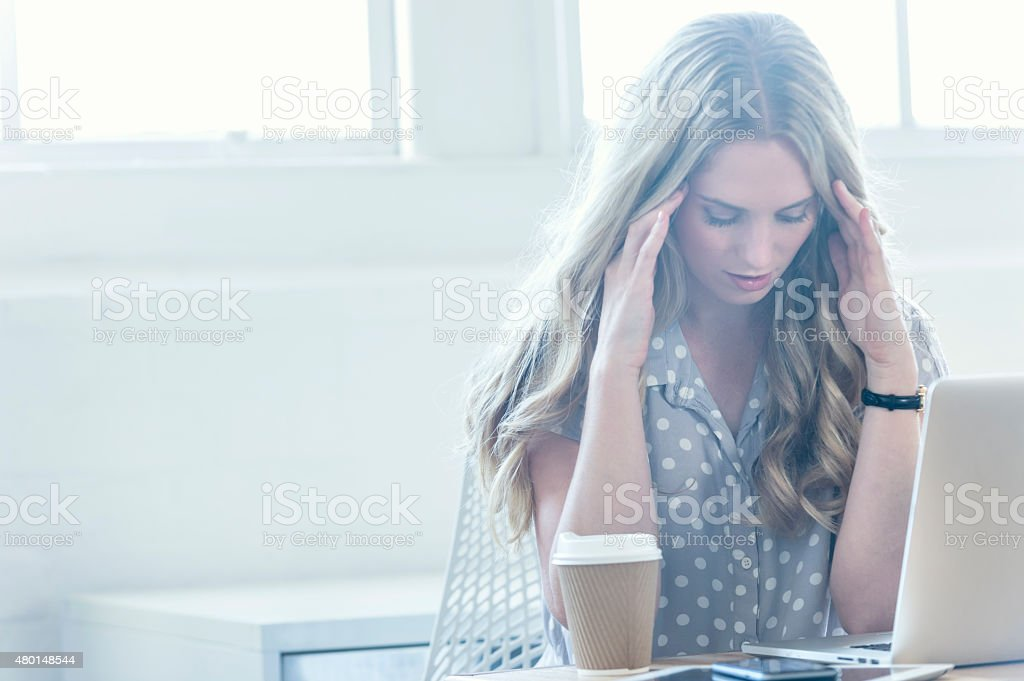 Stressed business woman working on a laptop. stock photo