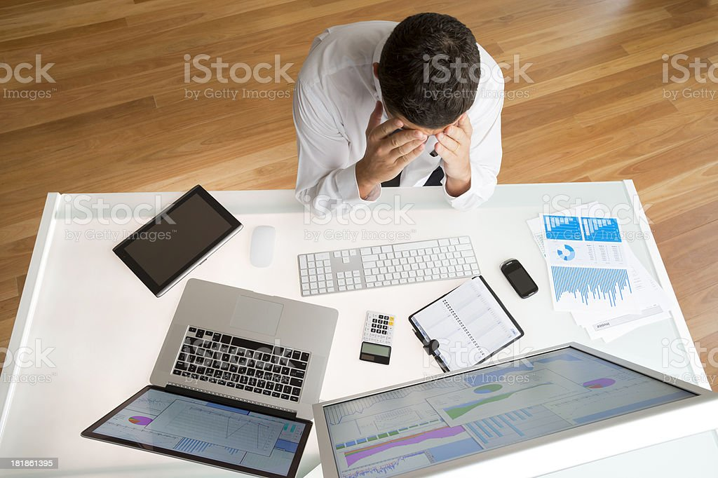 Stressed Businessman at his desk royalty-free stock photo