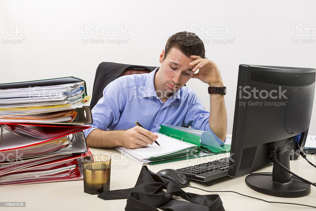 Stressed businessman at work royalty-free stock photo