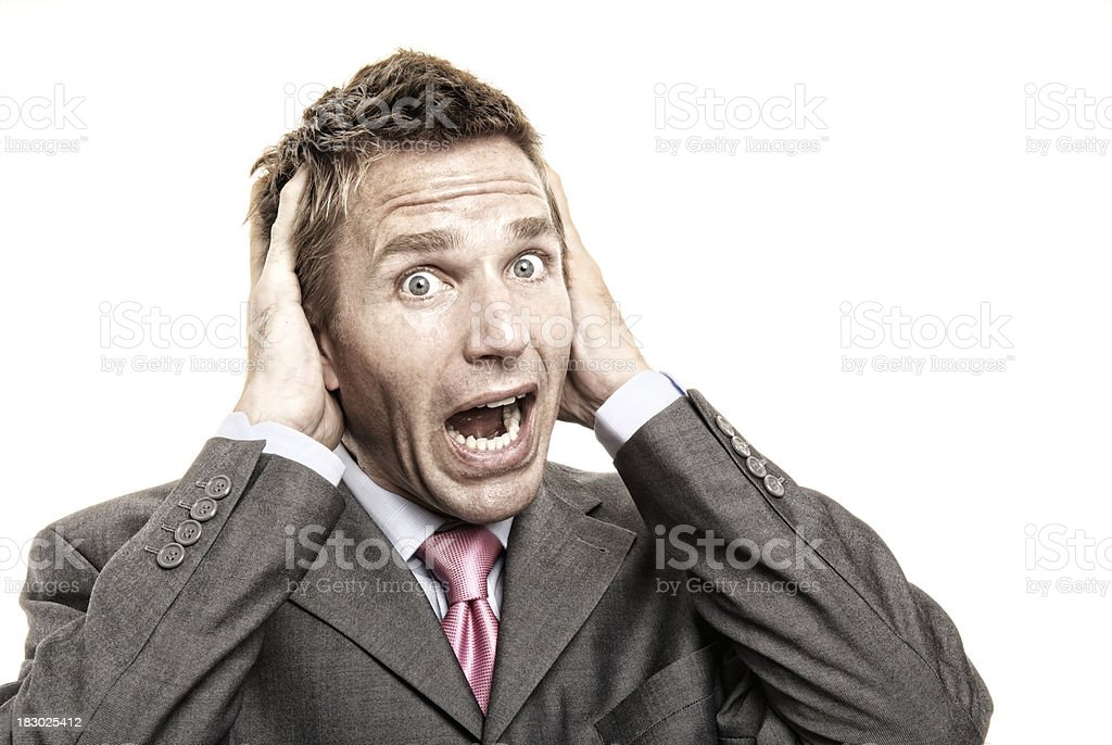 Stressed Businessman Holds Head in a Panic White Background royalty-free stock photo