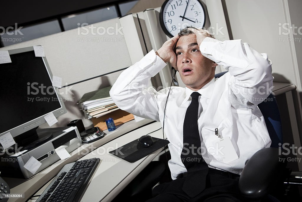 Stressed Businessman in Office Cubicle royalty-free stock photo