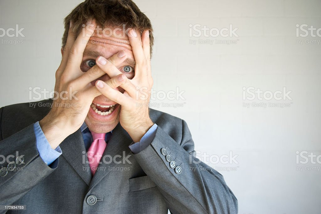 Stressed Businessman Looking Distraught Covering His Face and Screaming royalty-free stock photo