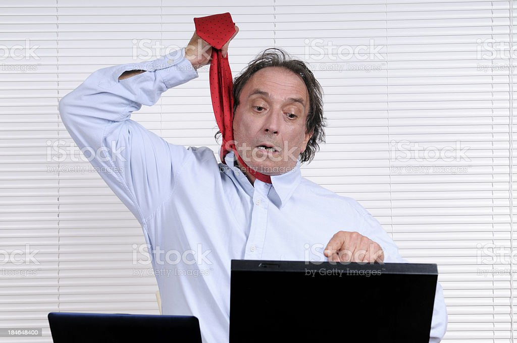 Stressed Businessman Looking PC royalty-free stock photo
