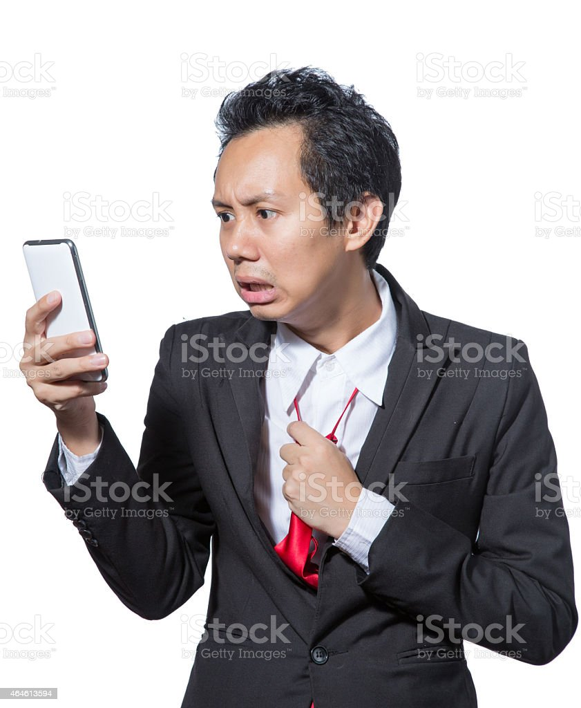 Stressed businessman looking tablet and pulling necktie stock photo