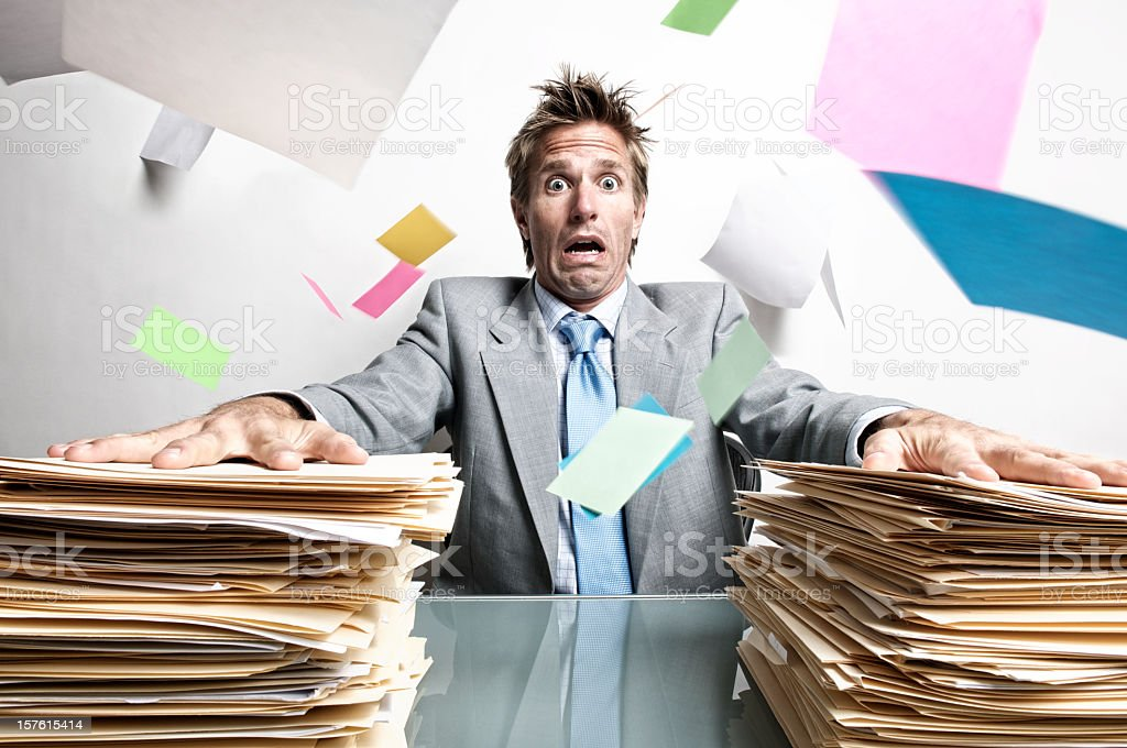 Stressed Businessman Office Worker Panicking at Inbox Chaos on Desk royalty-free stock photo