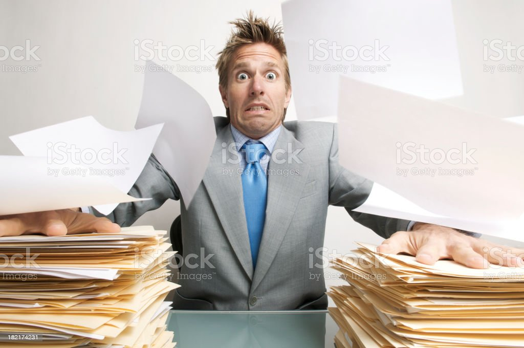Stressed Businessman Office Worker Tries to Keep His Inbox Down royalty-free stock photo