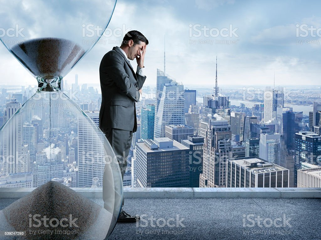 Stressed businessman running out of time stock photo