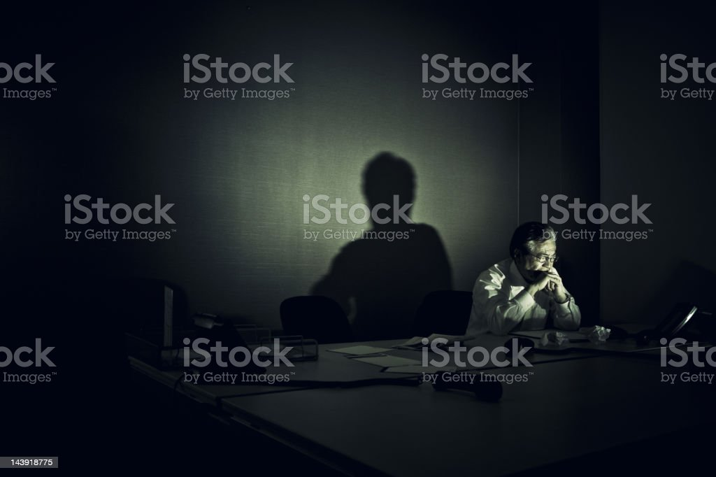 stressed businessman sitting alone in his office royalty-free stock photo