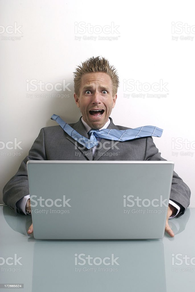 Stressed Businessman Sitting at Computer Frightened Expression royalty-free stock photo
