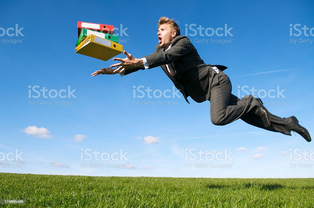 Stressed Businessman Tripping Outdoors Green Meadow for File Folders royalty-free stock photo